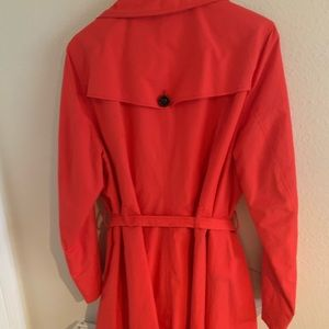 Coral cotton, belted trench coat.